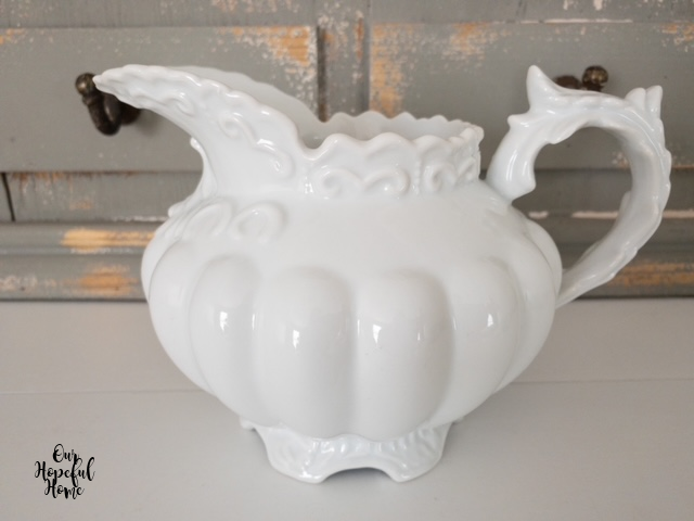 bulbous scrolly pointy white porcelain pitcher