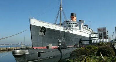 Ex Cunarder the Queen Mary of 1936 is alongside in Long Beach, California as a stationary Hotel Museum hotel