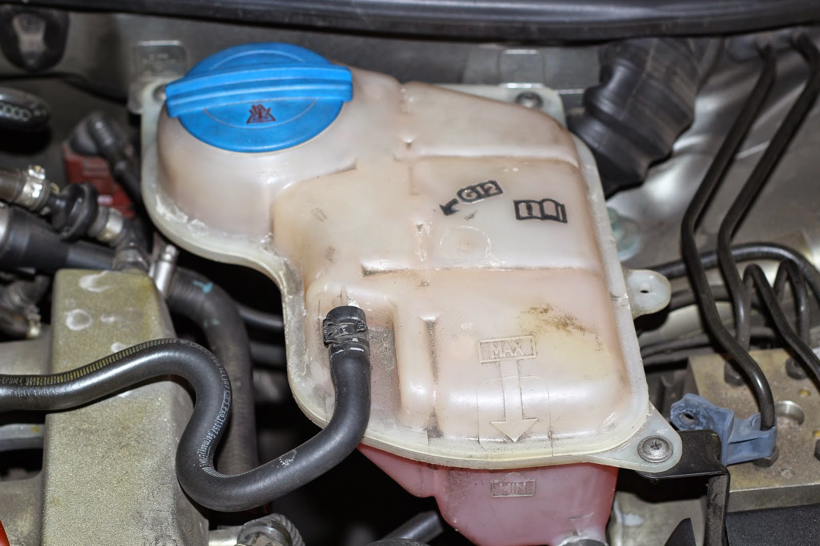 small resolution of remove three screws of the coolant tank lift it away remove the coolant sensor connector at the bottom of the tank gently lift it aside out of the way