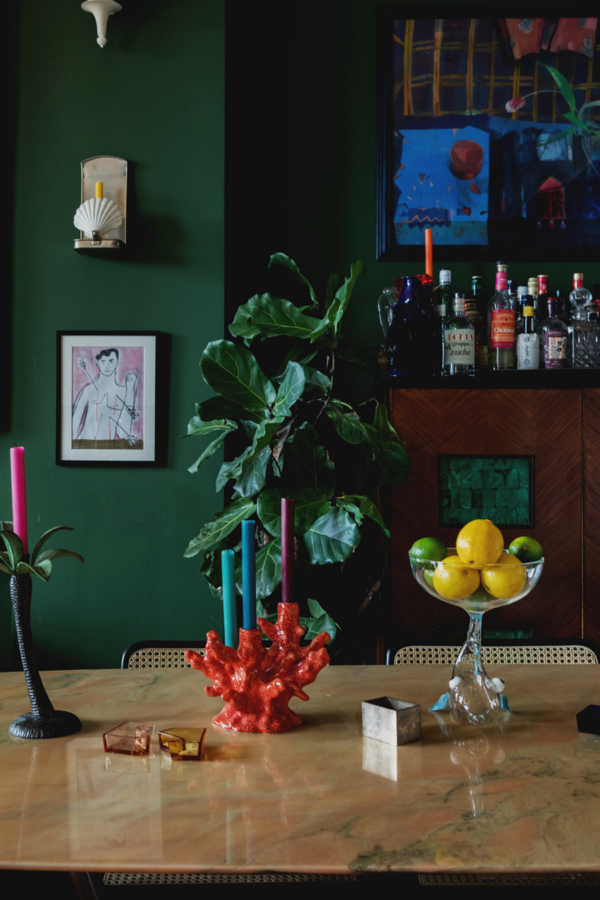 Loving the vintage touches and colorful candlesticks