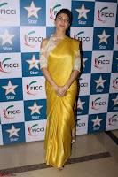 Gorgeous Jacqueline Fernandez  in yellow saree 04.JPG