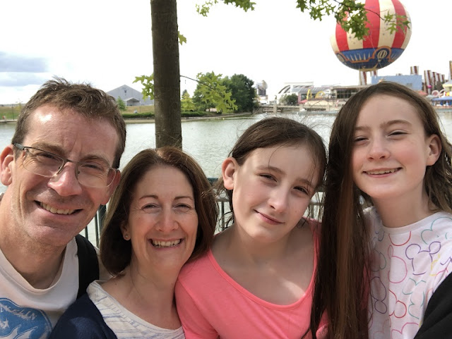 Family photo by the Disney Paris lake