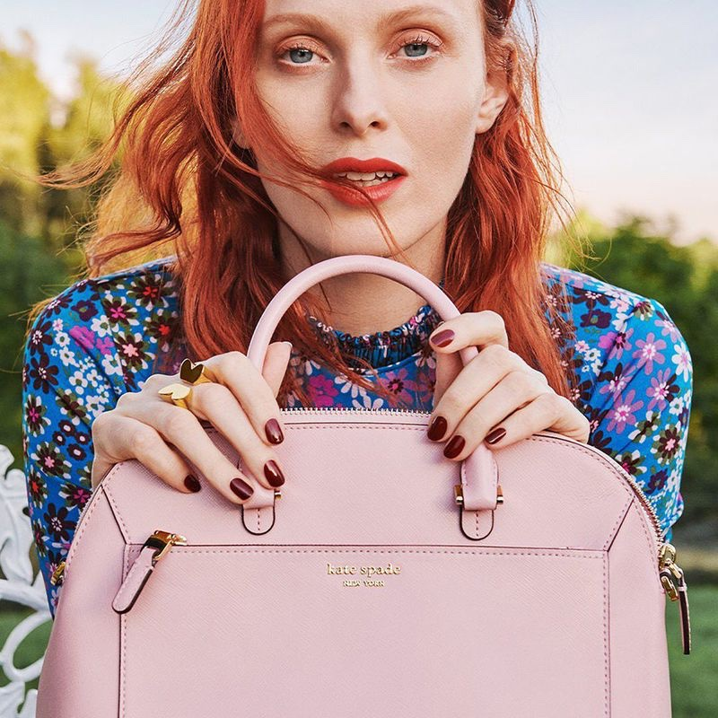 Karen Elson poses with pink bag in Kate Spade spring-summer 2020 campaign