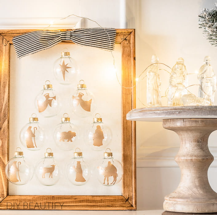 wood frame nativity with gold glitter ornaments