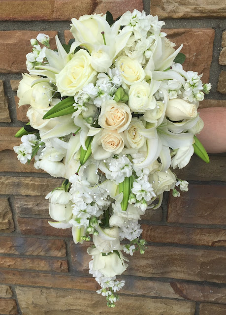 White Wedding Cascading Bridal Bouquet with roses, lilies, and stock flowers