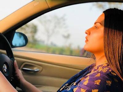 Himanshi khurana with her BMW car