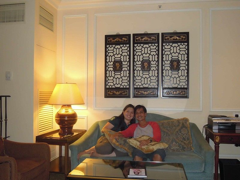 Couple travel blogger relaxing at the living room of their room at The Venetian Macao Resort Hotel