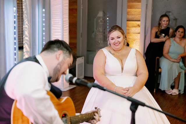 groom performs song for bride