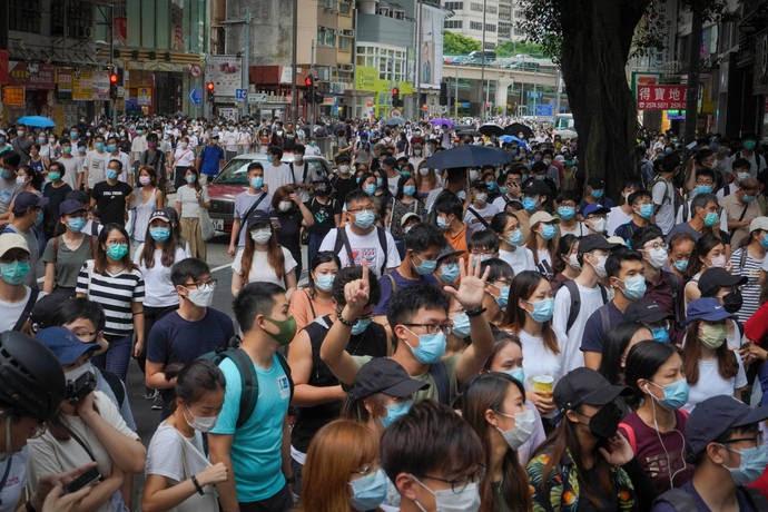 CHINA Blocks Hong Kong residents from getting British Citizenship - cover