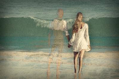 Holding hand on the beach