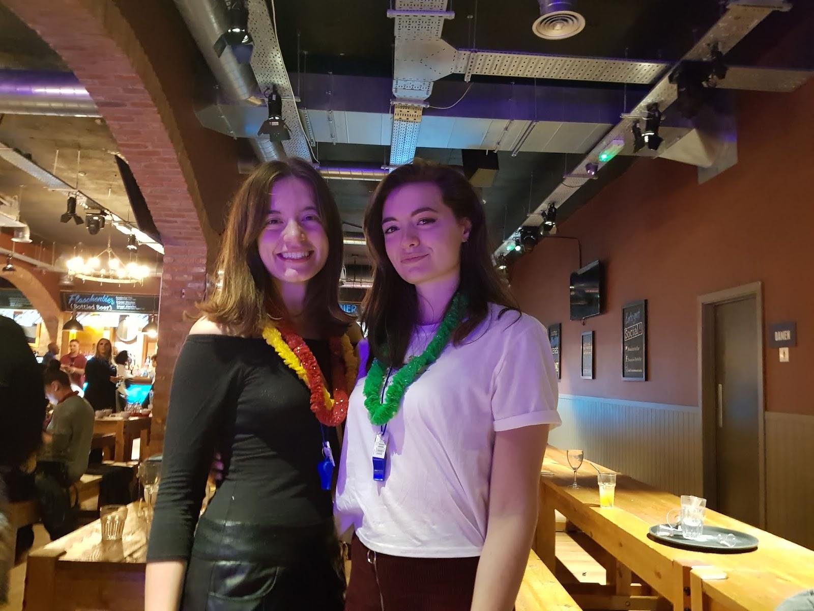 Two brunette Reggae Brunch attendees wearing leis