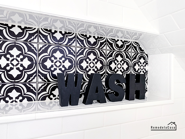 black and white tiles in shower niche - Wash black letters on it
