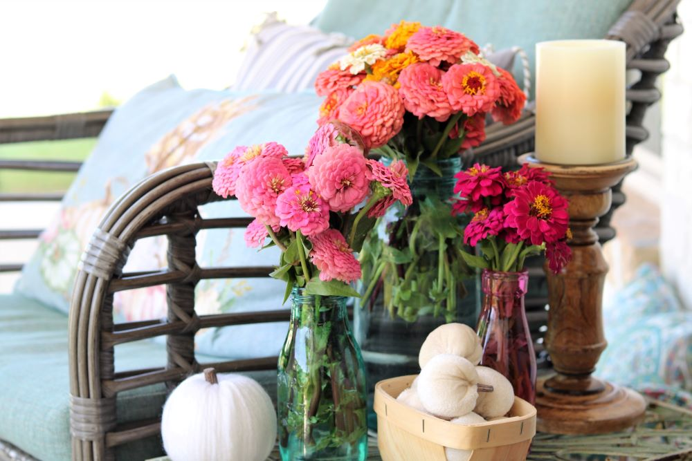 Fall-porch-welcoming-cozy-blankets-colorful-easy-tips-athomewithjemma