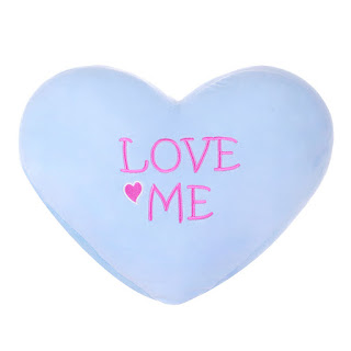 pastel colored heart shape pillows