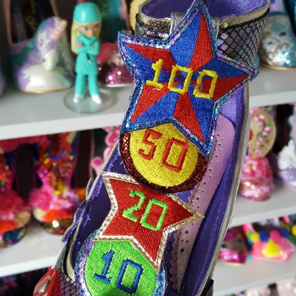 close up of embroidered score targets on T-bar of shoe