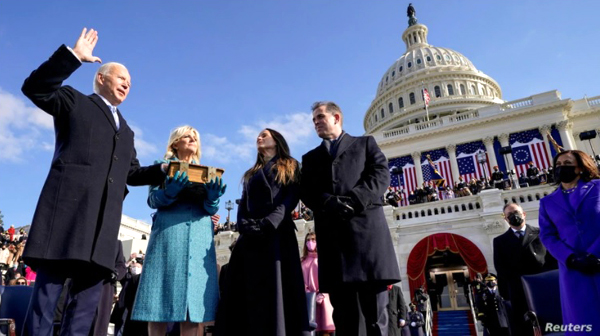 With his wife Dr. Jill Biden carrying the Bible, Joe Biden takes the oath of office as he is sworn in as the 46th President of the United States...on January 20, 2021.