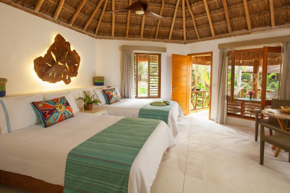 Stay steps from the pristine Playa del Carmen beach in upscale casitas and palapa-style accommodations at Mahekal Beach Resort, Mexico's premier resort.