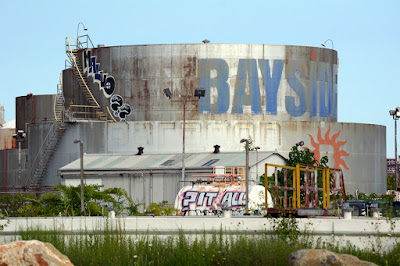 Heating oil storage tanks with Bayside logo and some graffiti