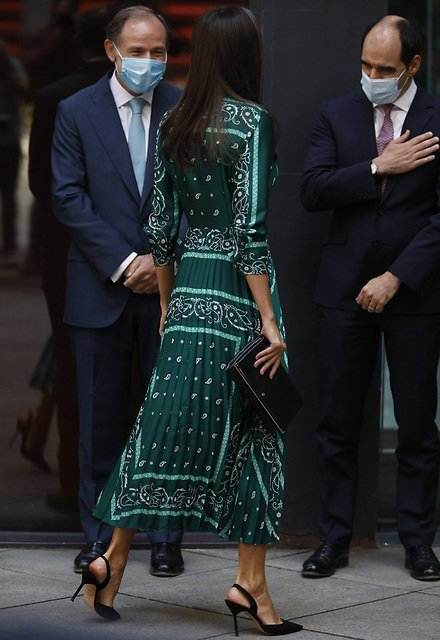 Queen Letizia wore a scarf print wrap long sleeve midi dress from Sandro. Minister Diana Morant and Director Ana Botin