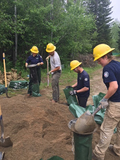 WCC members and staff filling sandbags in Cusick