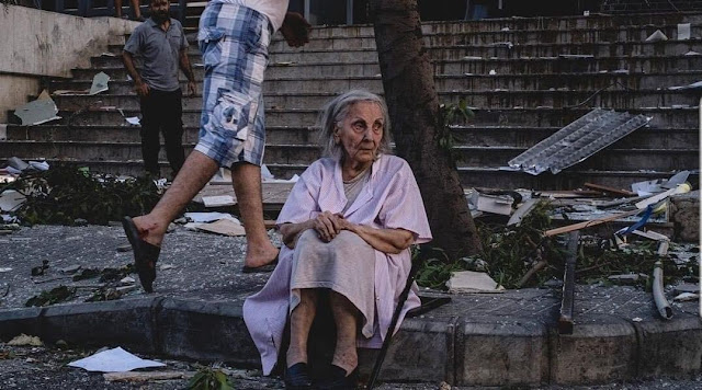 "An old Lebanese lady spending the night at the street due to the explosion  ""Twitter"""