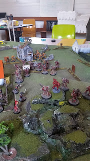 A photo of my Word Bearers facing the imperial fists in a game of warhammer 40000