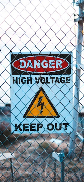Signboard with of high voltage on fence wallpaper