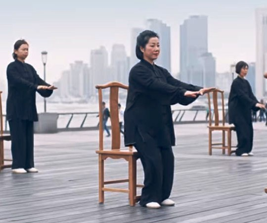 Tai chi practitioners in Shanghai show the brace position on a plane using tai chi moves.