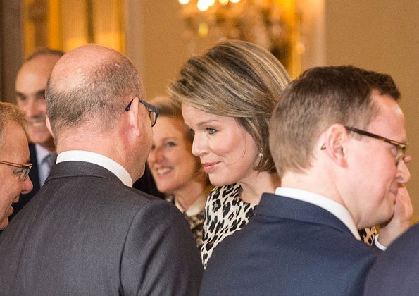 King Philippe, Queen Mathilde, Prince Lorenz and Princess Astrid attend New Year's Reception. Queen Mathilde wore Natan leopard-print dress