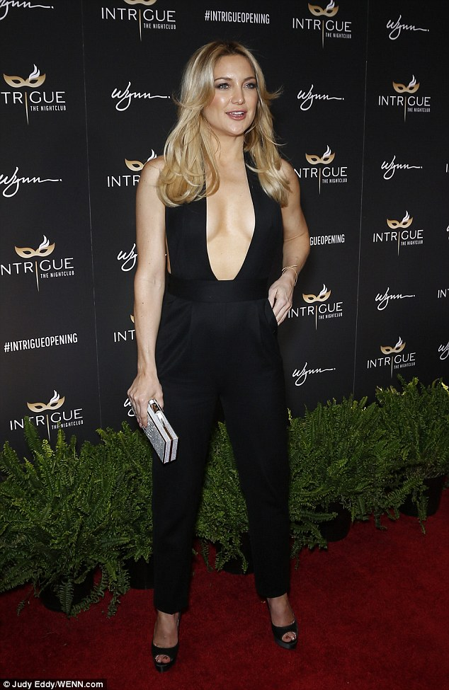 Kate Hudson goes braless in black jumpsuit at nightclub opening
