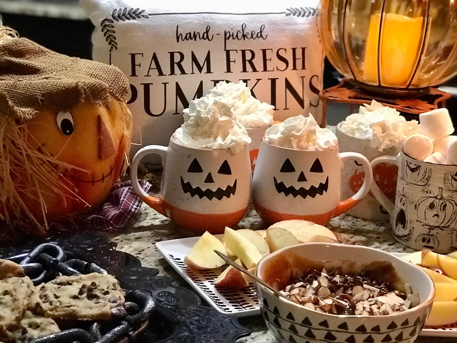 Tangie Bell planned Halloween Dessert Bar at home. Hot cocoa, carmel , apples and pumpkin decorations