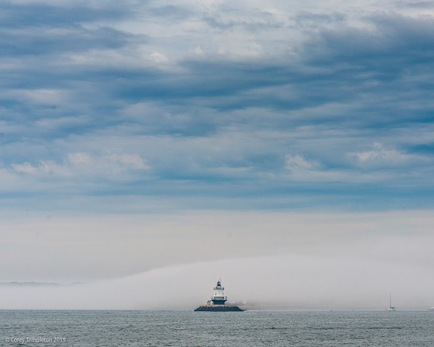 South Portland, Maine USA Photo by Corey Templeton. Thursday throwback to a foggy and cloudy sky surrounding Spring Point Ledge Lighthouse. July 2017.