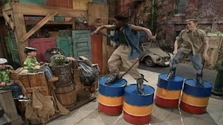 Oscar the Grouch, Grouchketeer, two members of Stomp, Can-Can game. Sesame Street Let's Make Music