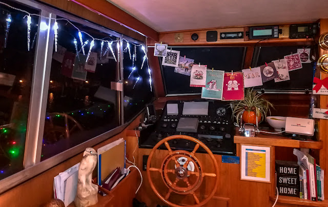 Photo of lights at the window and Christmas cards across the helm