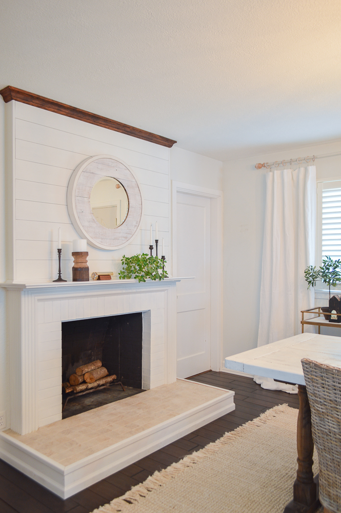 White fireplace shiplap above