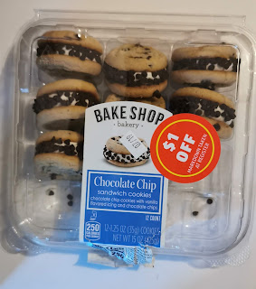 A carton of Bake Shop Bakery Chocolate Chip Cookie Sandwiches, with $1 off sticker, from Aldi