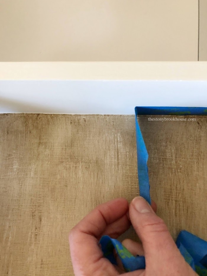 Peeling tape off of inside the drawer