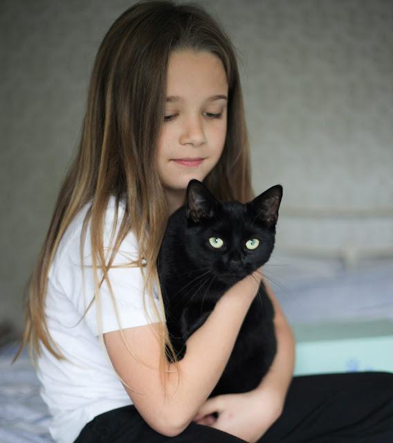 child and cat