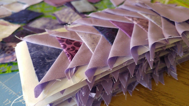 purple tiny paper pieced flying geese triangles