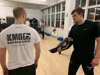 Krav Maga training of dealing with a knife threat from the side