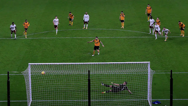 Ruben Neves scores from the spot during Wolves victory over Arsenal