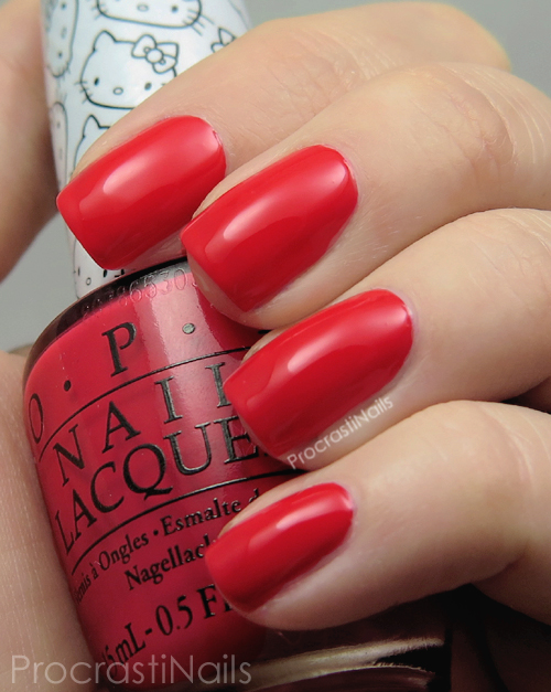 Swatch of the bright red creme nail polish OPI 5 Apples Tall