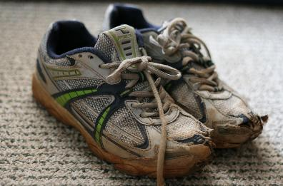 Pair Of Tennis Shoes From Holes