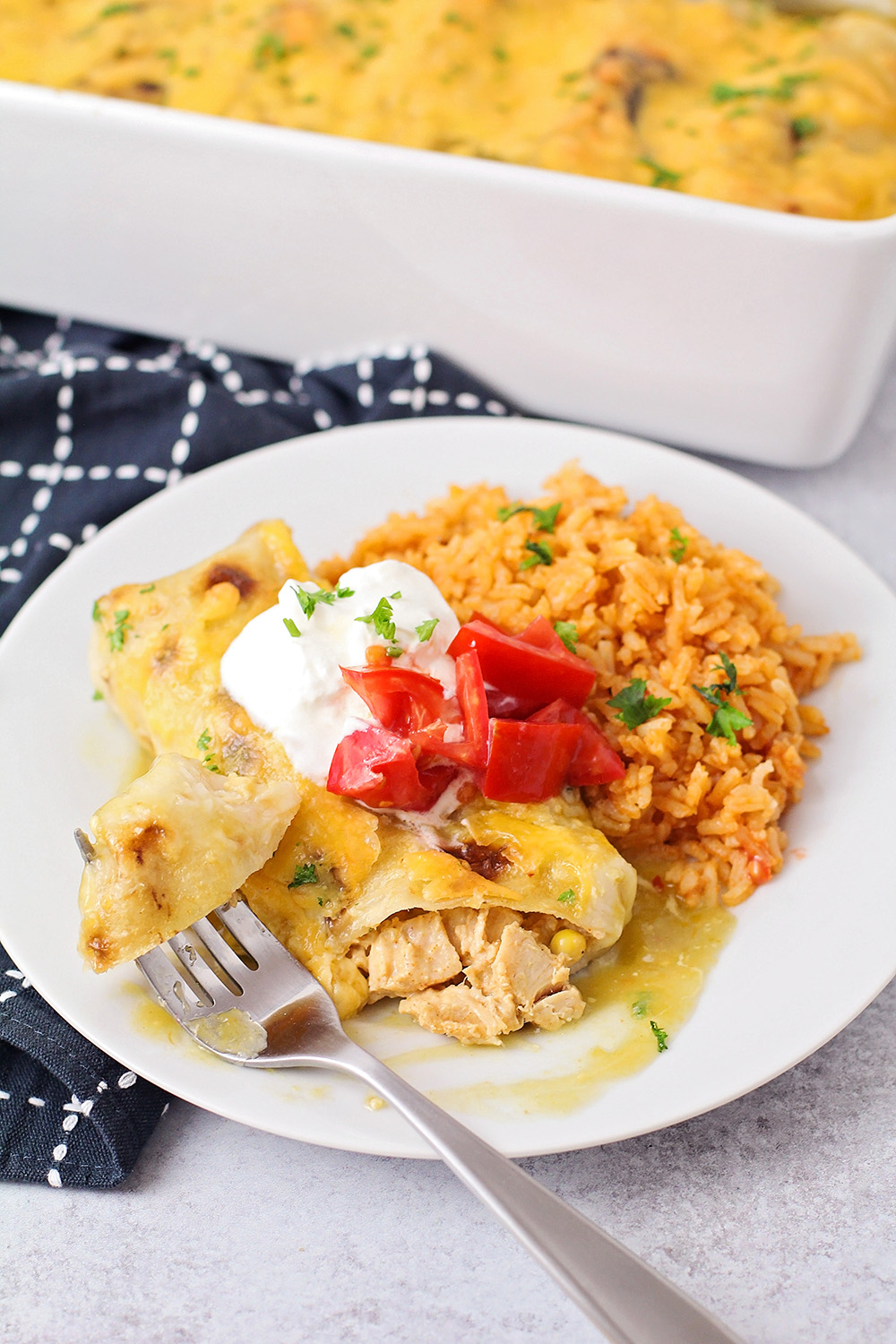 These creamy chicken and vegetable enchiladas are an easy and delicious dinner the whole family will  love!