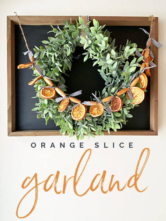 Orange slice garland on a wreath pin with overlay