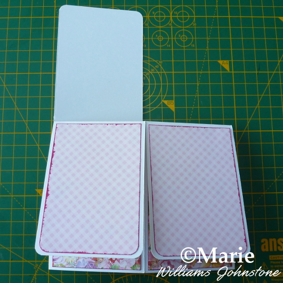 Adding patterned pink paper to the outside box card flaps