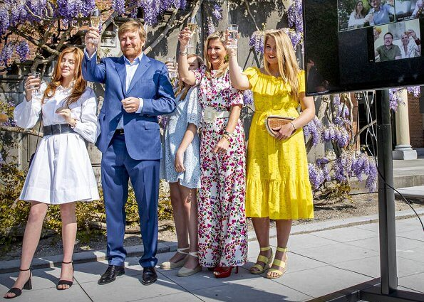 Queen Maxima wore a floral print silk jumpsuit by Seren. Princess Amalia wore a new cotton midi dress by Lisa Marie Fernandez