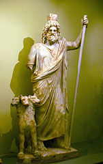 The Greek God of the underground world with his dog Cerberus.