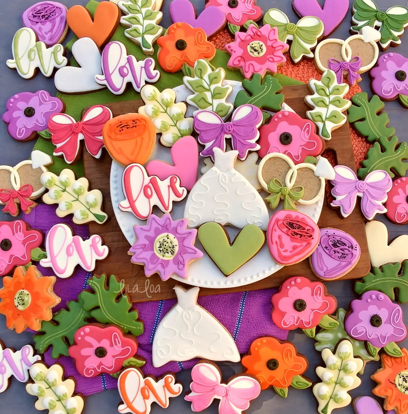 Brightly colored garden wedding flower chocolate sugar cookies
