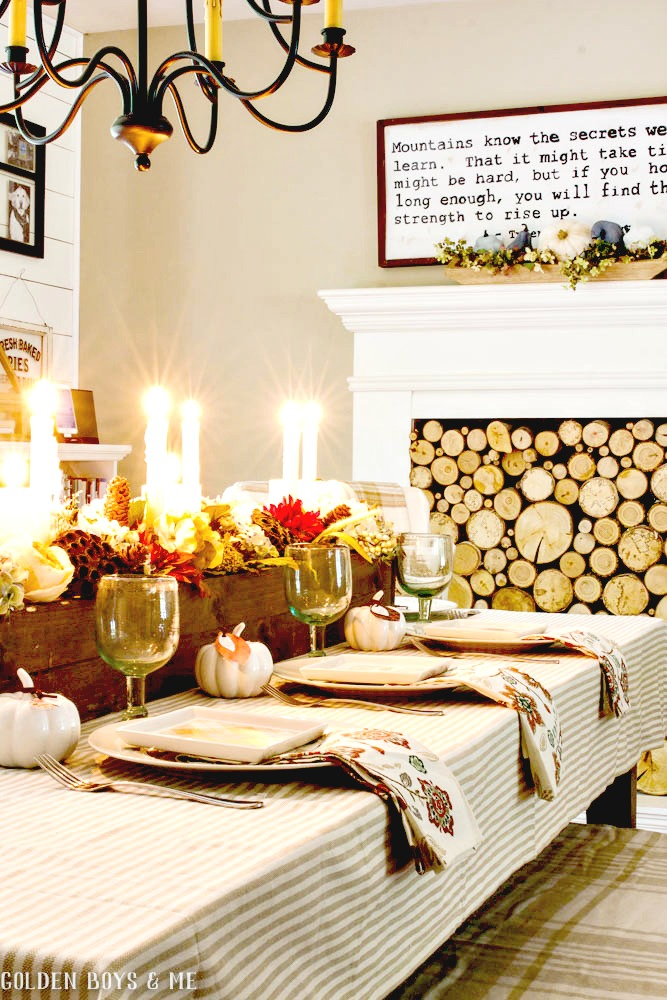 Fall dining room with DIY wood box centerpiece and faux fireplace